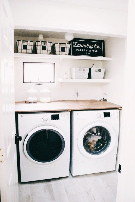 This; but double length of available space, with a pull-out ironing board under the bench top, and install two collums of laundry basket drawer bays; one on the left of each machine.
