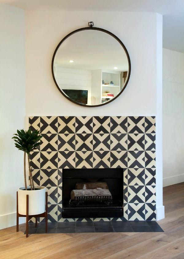 mosaic tile fireplace + round mirror