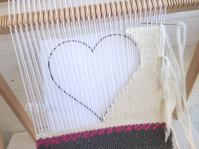 Learning to weave - wall hanging with negative space heart and wool roving // MollyMooCrafts.com
