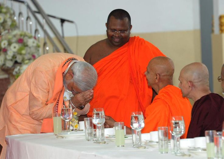 "Offering Dana(alms). PM @narendramodi offers "" दान"" to Buddhist monks from the Maha Bodhi society."