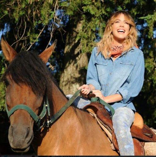 Violetta riding a horse