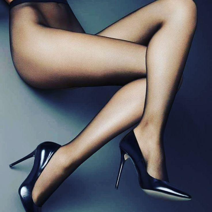 Long legs of black woman in short dress stock image