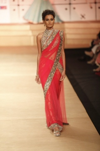 Sari - Delhi Couture Week 2012: Ashima Leena | Vogue INDIA : an interesting take on a sair blouse, i'm undecided though
