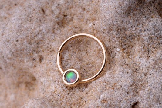NOSE RING 14k gold filled with synthetic Opal. 19 gauge hoop - Handcrafted. $14.95, via Etsy.
