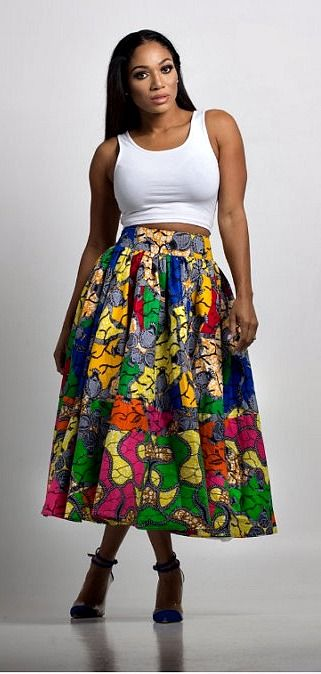 Eki Midi Skirt. This Gorgeous multi print skirt is a fabulous wardrobe must have. Pair it with a crop top or tank top for a fun day out or glam it up with a blouse and some heels for an event.   Ankara | Dutch wax | Kente | Kitenge | Dashiki | African print bomber jacket | African fashion | Ankara bomber jacket | African prints | Nigerian style | Ghanaian fashion | Senegal fashion | Kenya fashion | Nigerian fashion | Ankara crop top (affiliate)