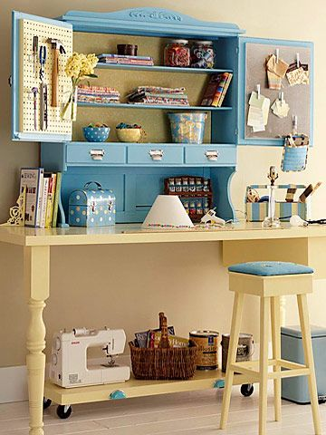 A solid-cor door can easily be turned into a crafting table anchoring it to the wall and adding two legs. Top off your table with spruced up hutch.