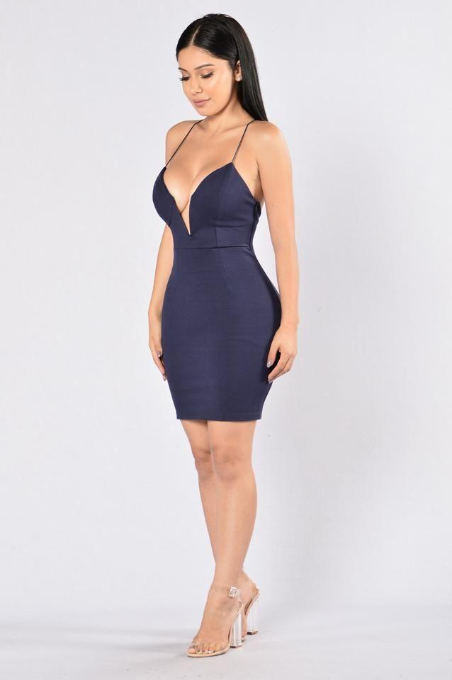 - Available in Cognac - Mini Dress - Fitted - Criss Cross Back - Spaghetti Straps - Low V Neckline - 96% Polyester, 4% Spandex