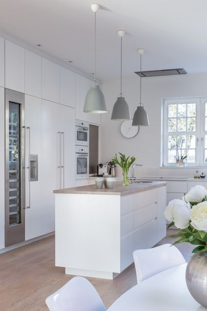 Kitchen Island Light Tip: As a general rule of thumb, the more copies of a pendant you're hanging, the simpler the pendant should be. They might not seem striking if used individually, but together their architectural look is beautiful. (Caravaggio matt pendant in grey by Lightyears)