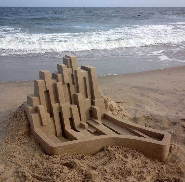 Artist Calvin Seibert spent part of the summer on Rockaway Beach in Queens where he made quick work of erecting several of his trademark geometric sandcastles that we've admired for years here on Colossal.
