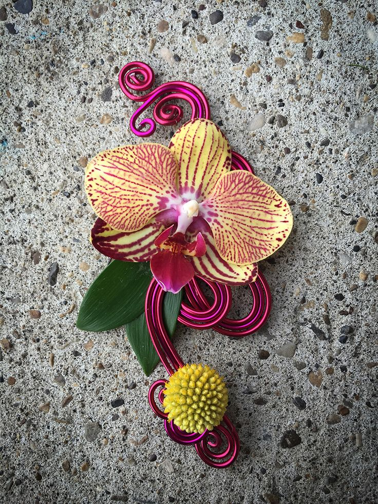 Elegant contemporary dark pink boutonniere with phalaenopsis orchid and craspedia on a base of decorative magenta wire. This would also be equally stylish as a contemporary corsage. | By http://www.fleurdelise.ca |