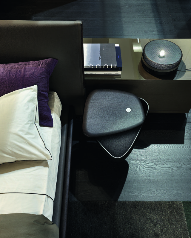 Poliform_Ipanema_a detail of the new bedside table integrated in the headboard in spessart oak finishing. The bedside table has a swivel drawer with leather or techno-leather covered interior. At the back of the bed: visone glossy lacquered Bristol sideboard.