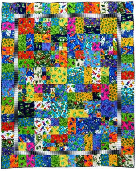 Stash Friendly Quilt - Tracey Roberts Designs Grab all your novelty fabrics, like I did, or a collection of modern fabrics and make this quick quilt.  A great project for a beginner quilter or when you want to make a quilt from your stash fabrics.