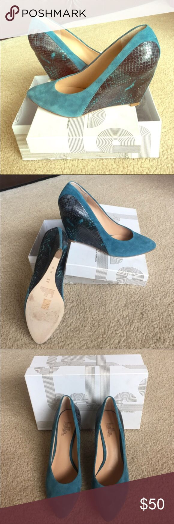 """Stylish Belle Sigerson Teal Wedges 8.5-9 3.5""""wedge heel with snakeskin print. They are very stylish and great quality.   Original price: $298.00  Does not come with box. I wear a 9-9.5 and they are a little snug on me. I feel that these will fit someone that's a 8.5-9. Belle by Sigerson Morrison Shoes Wedges"""