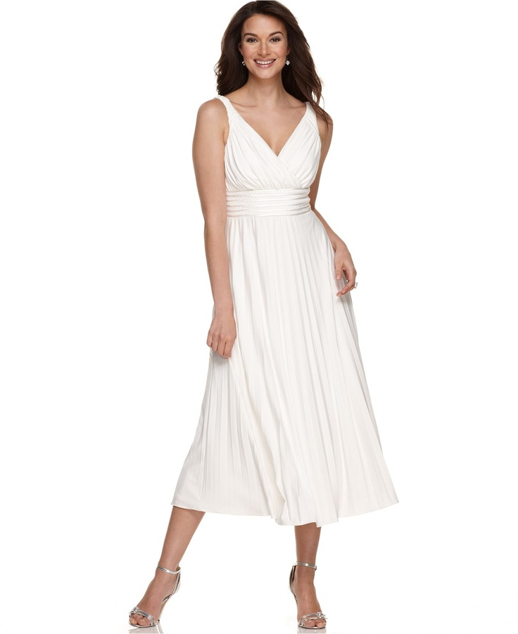 Really like this white flowy sleeveless dress for a casual