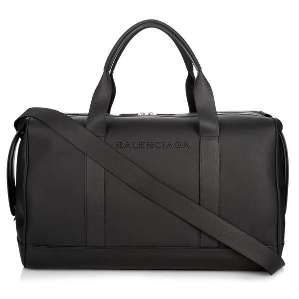 The Black Rubberized Leather Holdall Bag by Balenciaga takes the casual duffle bag to a whole new level. Crafted in a unique rubberized leather, the bag comes w