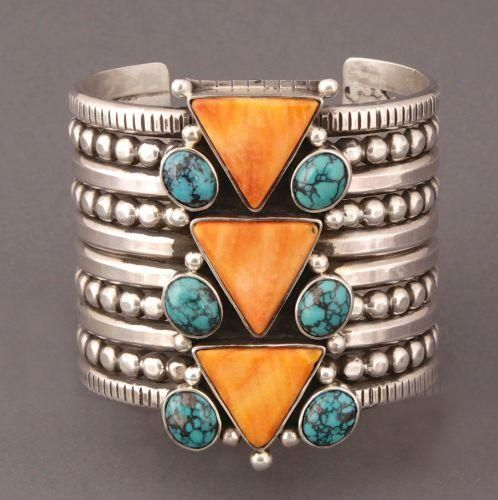 """Mike Bird Romero Bracelet of Turquoise and Spondylus - This is one of Marti Struever's personal favorites! A large silver bracelet by Mike Bird Romero is set with 3 spiny oyster triangles, each triangle is decorated by 2 natural turquoise circles and two silver beads for quite the fun geometric effect. , Mike Bird Romero has accented the silver cuff with four rows of silver beads. The large bracelet measures 2 5/8"""" wide. The terminals open 1 1/4"""" and the inside circumference is 5 1/4""""."""