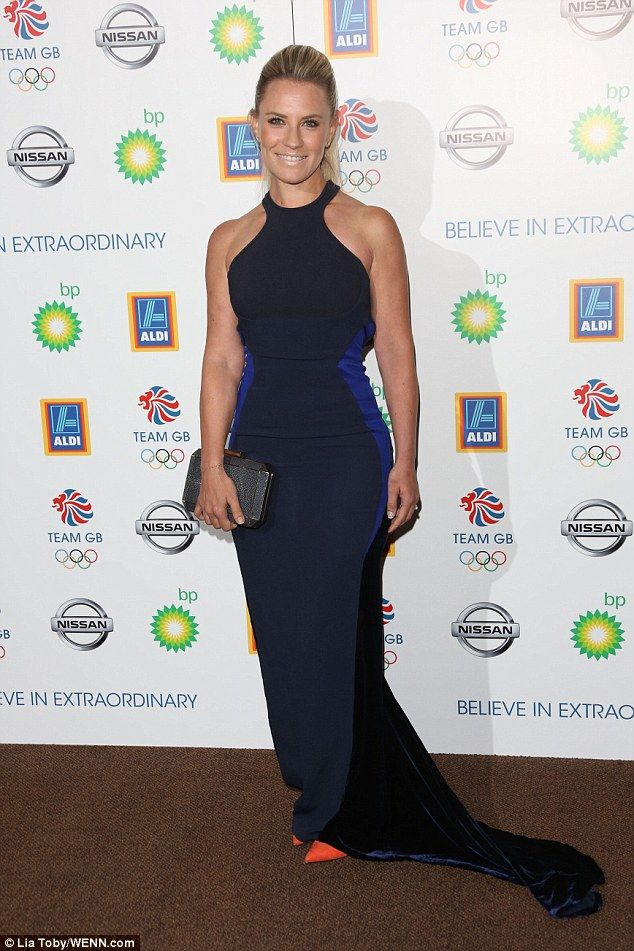 Beauty: TV presenter Georgie Thompson wowed as she covered her slim, shapely figure in a tight navy blue dress