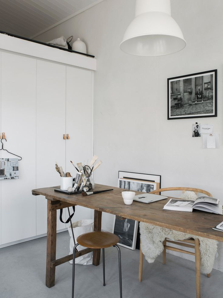 Inspiring workspace with big storage cupboards
