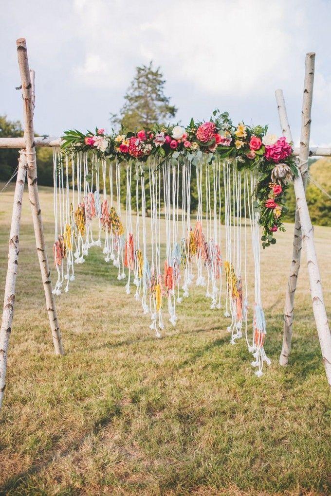 Boho alter with birch tree poles, a handmade yarn hanging, and all the pretty blooms! #cedarwoodweddings   Cedarwood Weddings