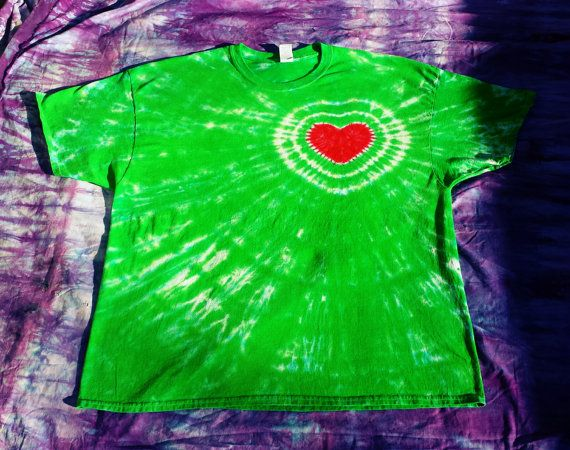 The Grinch had a heart that was two sizes too small! I tie dye on Tuesdays, wash out Wednesdays. Any orders that are received by 9 a.m. on Tuesday will go out by the end of the week. If you have a special timing request, please message me. Gildan Brand, Cotton 100%, Will not shrink anymore, but sizes are approximate due to manufacture differences. (in inches) S M L XL 2XL 3XL BODY LENGTH 28 28 29 29 31 30 BODY WIDTH 17 19 21.5 23 24.5 26 SLEEVE LENGTH 6 6.5 7 7.5 7.5 7.5  Your shirt will…