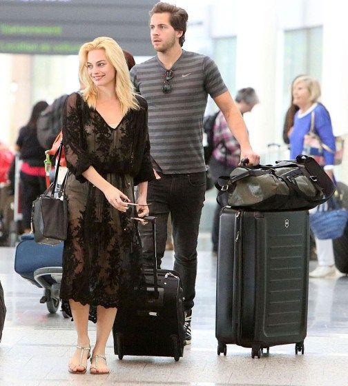 Margot Robbie and boyfriend Tom Acklerley arrive at Toronto Airport.
