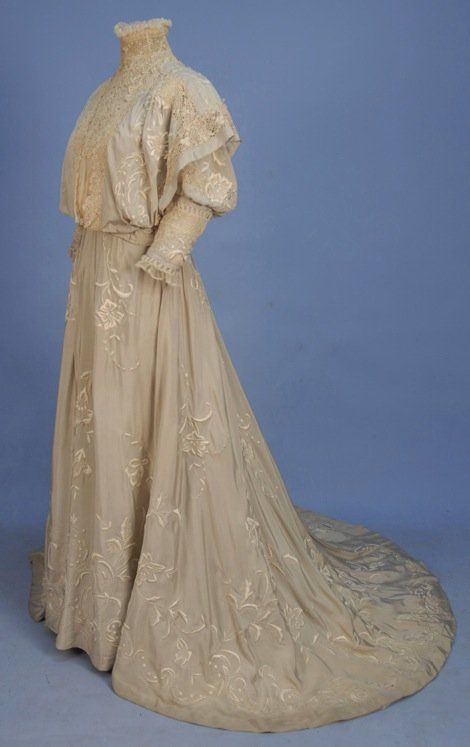 ~TRAINED SILK HIGH NECK GOWN with EMBROIDERY, 1890s~  Grey 2-piece with white floral in satin stitch and French knots, pigeon-breasted bodice with Irish crochet neck insert and trim bands to shoulder over-panels, upper puffed sleeve and fitted elbow band, skirt having tucks at front and side waist, back gathers, silk faille underskirt with pleated hem band. Cleveland label.