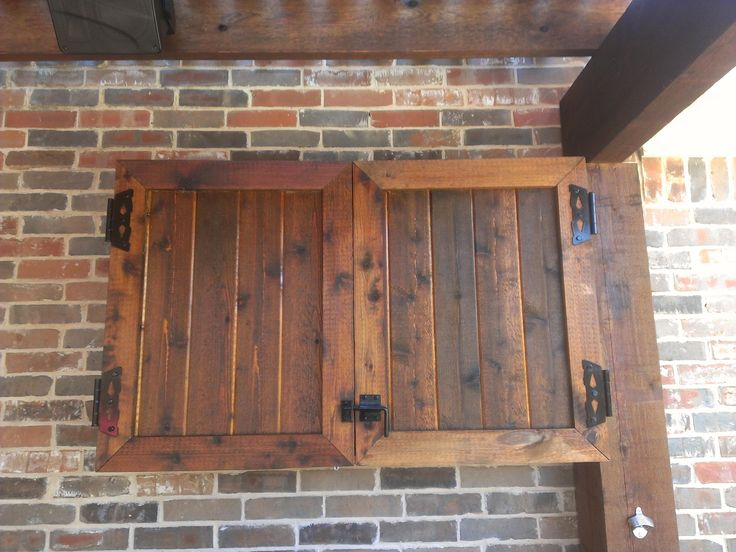 Rustic Wooden Outdoor Tv Cabinet With Bi-fold Door Cabinet Attach Stacked Brick Exposed For Patio Decorating Ideas