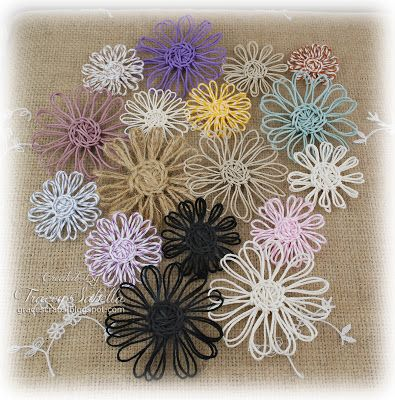 Really Reasonable Ribbon Blog: Twine Flower Tutorial and Father's Day Card  The tutorial is great! Updates and hints included plus picutres. The ones made with metallic twine are ornament worthy. I am wondering if you could do these small enough for earrings.