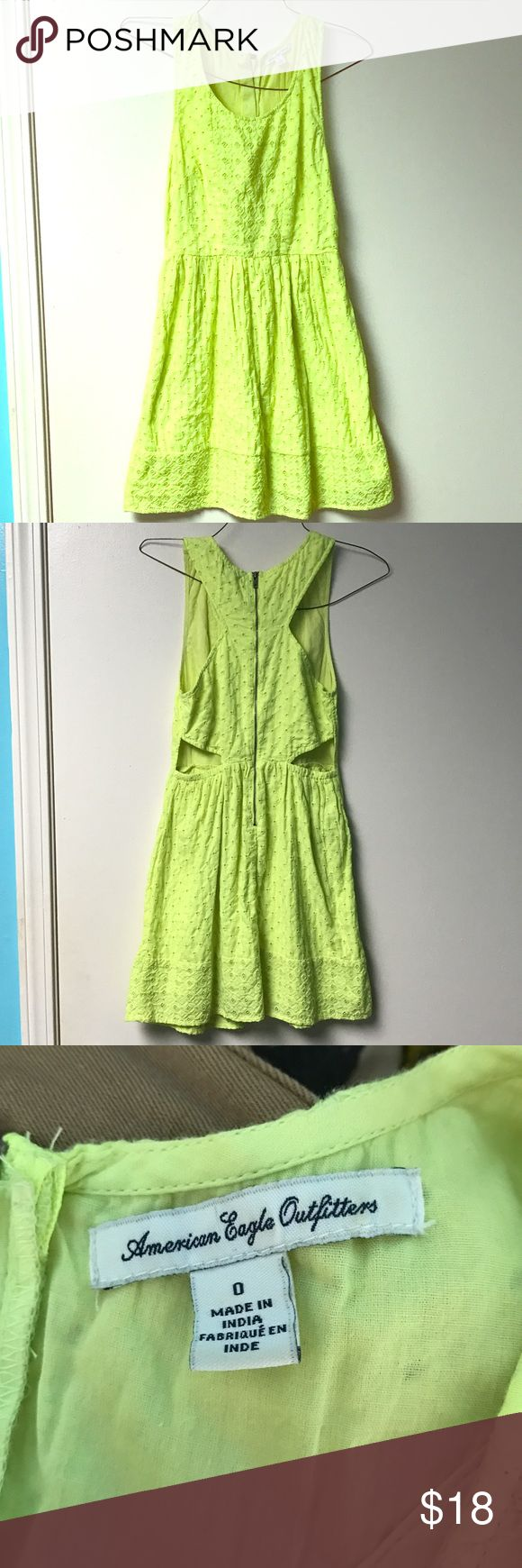 Neon yellow summer/spring dress This dress does have two cut outs on the back/side. It is a super cute causal dress. It is a bright yellow dress like neon. American Eagle Outfitters Dresses Midi