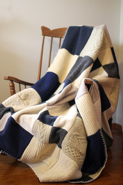 Old sweaters made into a quilt. Really sweet and cozy way to warm up our home.