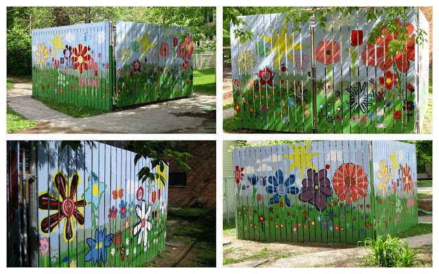 Flower fence painted by 5th graders (around compost) - good idea for our concrete wall.