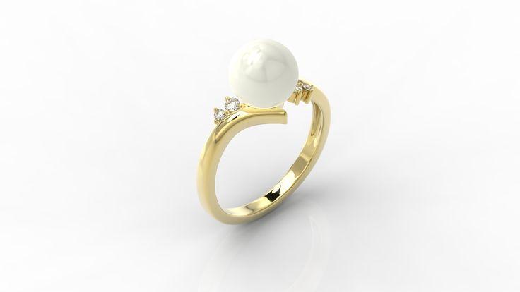 Złoty pierścionek z perłą i diamentami./  Gold ring with pearl and diamonds.