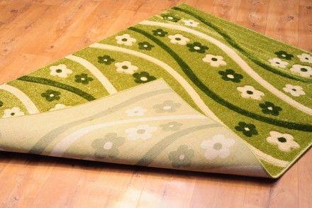 Dywan ręcznie wycinany Kwiatuszki zieleń. Dywan w kolorze zielonym ze wzorem kwiatuszków, idealny do pokoju dziewczęcego.