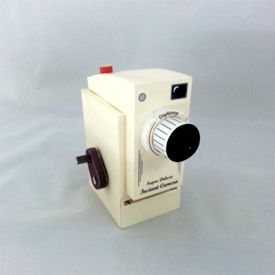 Papercraft project: Vintage instant camera made from paper. This toy ejects 'real' instant photos when you turn the crank.