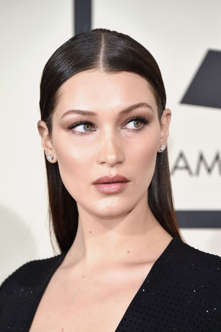 Bella wore her hair in a so-now slicked back style that looked almost wet from the front. Her makeup featured earthy neutrals that contoured her model features and accentuated her lips. - Cosmopolitan.co.uk