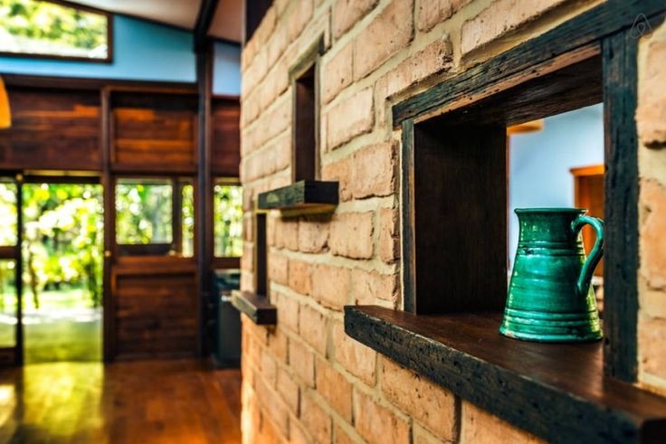 House in Urunga, Australia. Big timber slab and mud brick handcrafted open plan house with vast verandas & beautiful bathhouse,on acres with organic macadamia orchard with many kangraoos..Walk to Hungry Head beach. 20 mins to Bellingen, 20mins to Coffs Harbour, 5 mins to Uru...