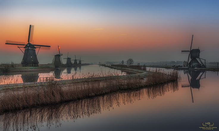 Orange Dreams III - A wonderful wide view over Kinderdijk's windmills while standing on the main bridge on a cold morning in March................