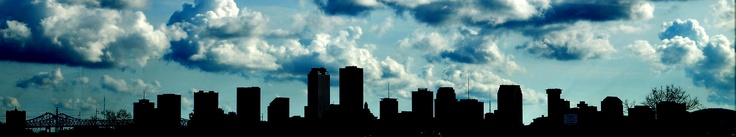 New Orleans skyline silhouette taken from the New Orleans Fairgrounds grandstands.