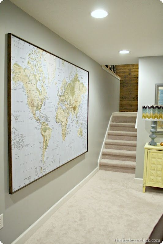 Ikea world map.  It comes ready to hang, but this blogger added a dark stained frame with thin lattice boards attached to the frame with a glue gun.