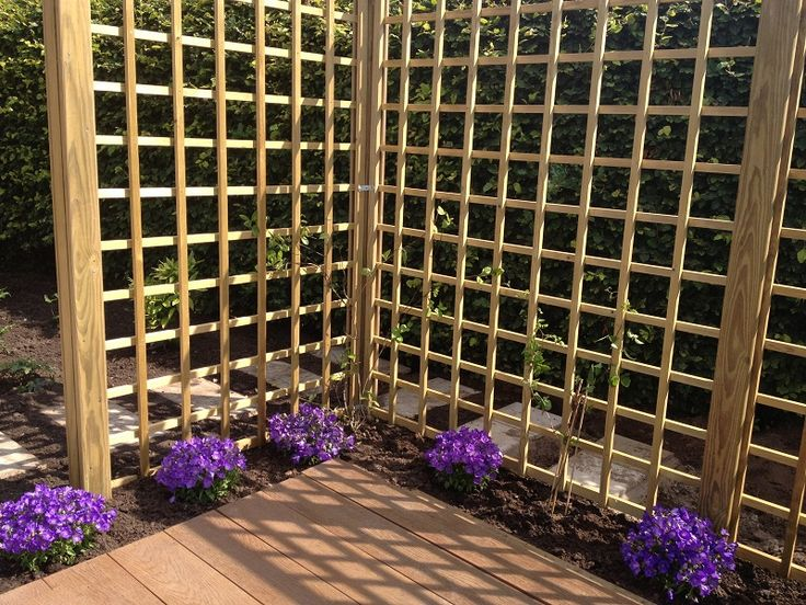 After photo - trellis clothed with climbing plants will make this corner deck a secluded & shady place to sit