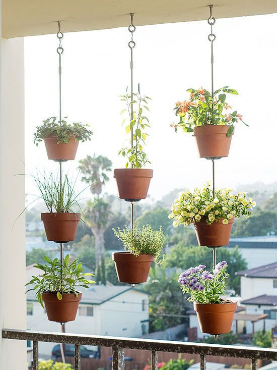 Hang rows of simple terra-cotta pots from above to form a vertical garden that doubles as a screen.