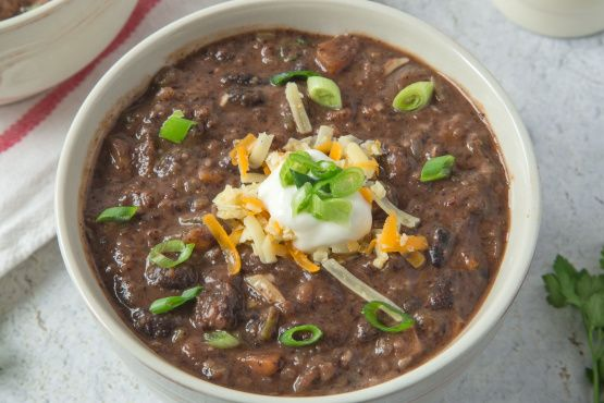 From www.TopSecretRecipes.com I got this copycat recipe off of Top Secret Recipes site.I love Fridays Black Bean Soup because of its spiciness and I was so happy to find this! This is so easy to prepare! You can make this soup on the stovetop or in the slow cooker.I brought this soup to a boil on the stove and then put it in the slow cooker and let it simmer on low for 2-3 hours. If you like black bean soup, youre gonna love this!