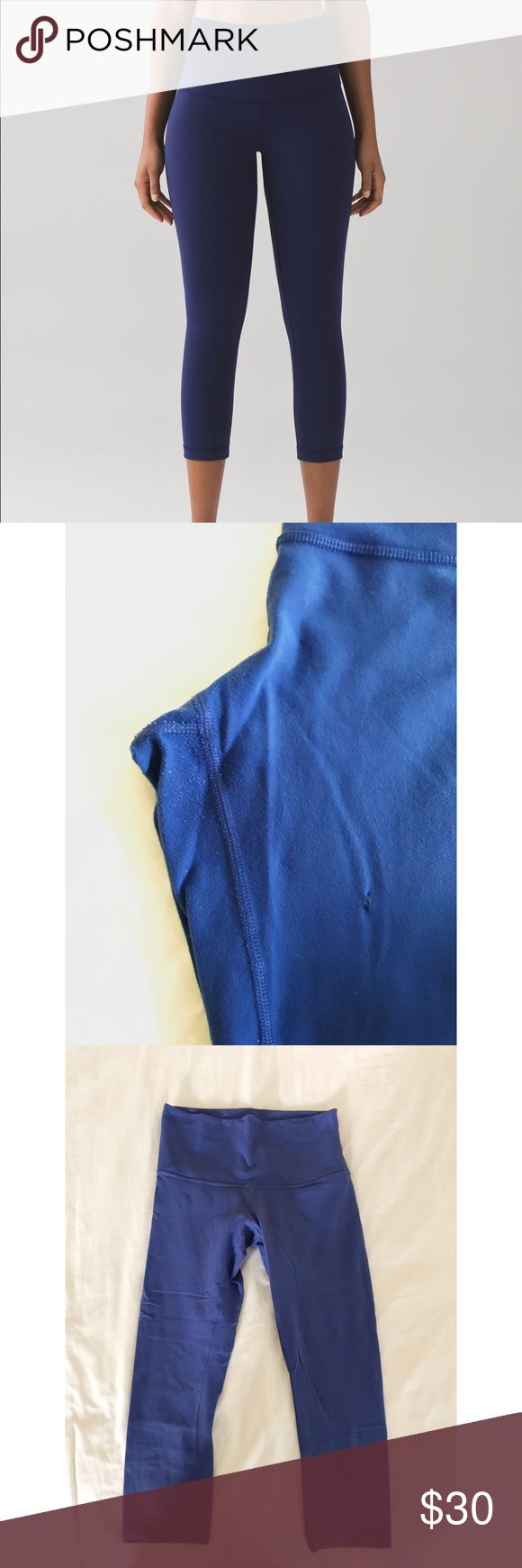 """Lululemon high rise wunder under These pants have been worn. The last picture shows a detail of some pilling in the crotch area as well as a slight """"hole"""" (that has been sewn up with matching thread.) The tiny hole was from a fire spark so the material is seared and will definitely not get bigger. I've worn them for a long time like this and it is hardly noticeable when on. They no longer fit me but thought someone might like to extend their life for a cheap price! Size tag has been removed…"""