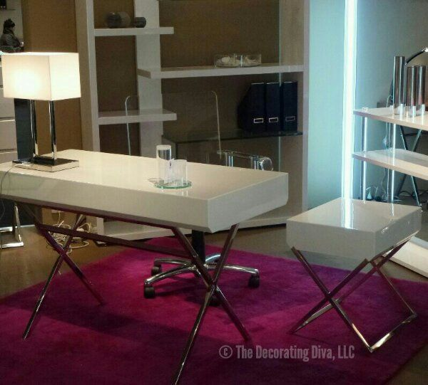 Fuchsia rug and white modern furniture combination.