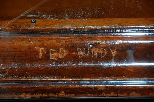 When Ted Bundy was on trial he carved his name into a Orange County Courthouse table.