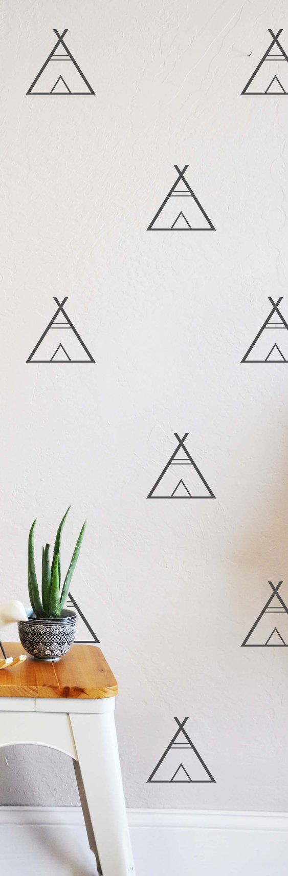 """32qty - 4""""h x 4""""w tee pee wall decal  The interior is cut out so that the wall shows through as the background.  It is sent with a transfer tape application.  Fully removable and reusable wall decals that will brighten and add  character to any room.  **PLEASE NOTE THAT METALLIC VINYL IS NOT REUSABLE**  -100% polyester fabric self adhesive vinyl -HP Latex Inks  ARTIST THE LOVELY WALL"""