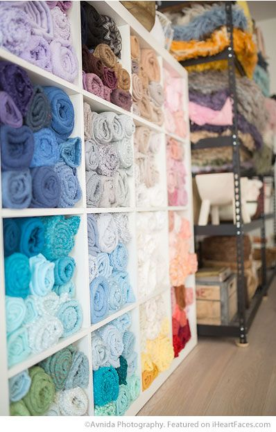 Lots of colored blankets in Avnida Photography's beautiful newborn studio - featured on I Heart Faces