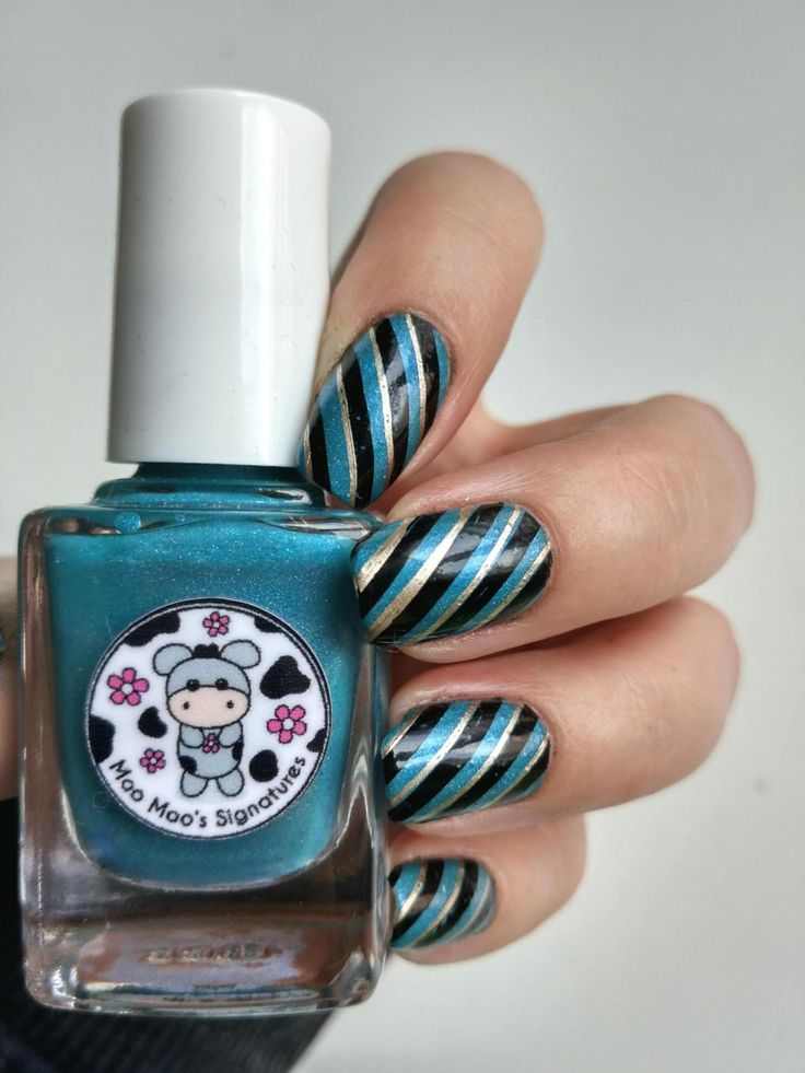 Candy Striped Nails in turquoise, black and silver.