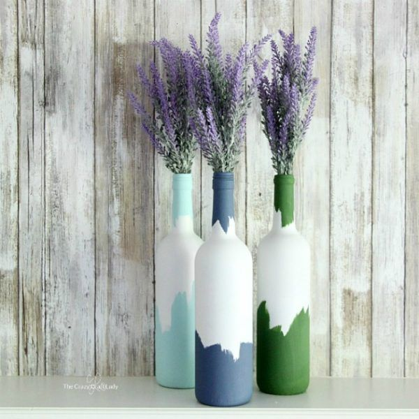 Wine bottle upcycle - white spray paint outside, colored chalk paint brush on top