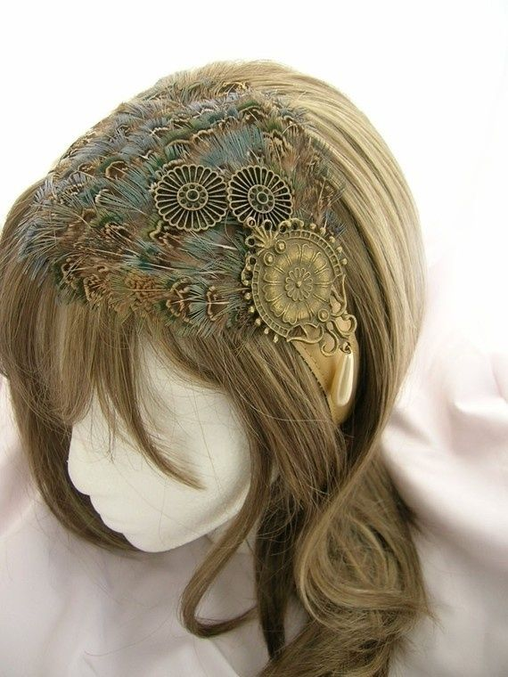 A cute steampunk feather headpiece! Browse deeper in our Steampunk Hats section to find more. http://www.steampunkshoppe.com.au/shop/